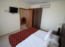 Апартамент с двумя спальнями на первой линии моря. Фото 13